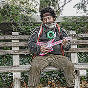 As I exited Ft Tryon Park, I came across this man playing his guitar.  He smiled and agreed when I asked to photograph him.   And then went back to his music