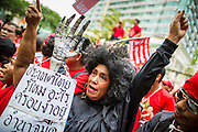 "10 DECEMBER 2012 - BANGKOK, THAILAND: Red Shirt protesters picket the Pheu Thai offices in Bangkok Monday. Although the Red Shirts support Pheu Thai, they are calling on the party to speed up constitutional reform. The Thai government announced on Monday, which is Constitution Day in Thailand, that will speed up its campaign to write a new charter. December 10 marks passage of the first permanent constitution in 1932 and Thailand's transition from an absolute monarchy to a constitutional monarchy. Several thousand ""Red Shirts,"" supporters of ousted and exiled Prime Minister Thaksin Shinawatra, motorcaded through the city, stopping at government offices and the offices of the Pheu Thai ruling party to present demands for a new charter.         PHOTO BY JACK KURTZ"