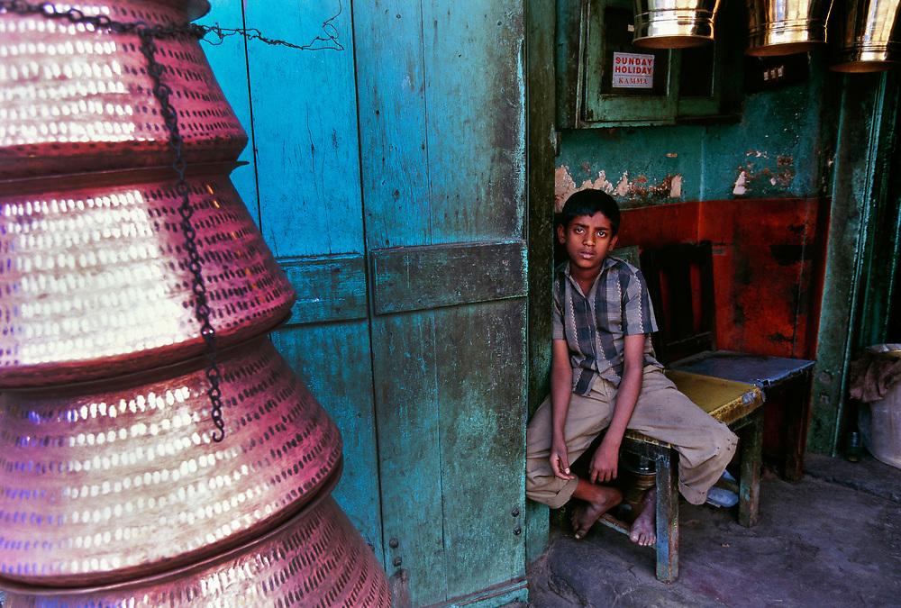 Boy selling copper appliances, Madurai, Tamil Nadu, southern India