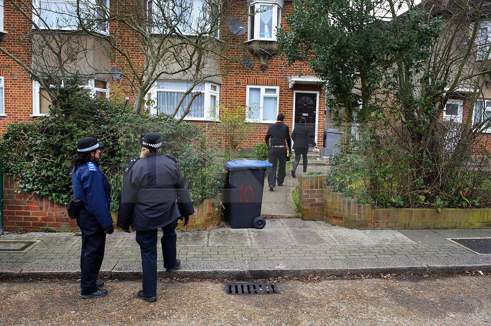 © Licensed to London News Pictures. 10/01/2014 Harrow, UK. Police officers outside a ground floor flat on Woodgrange Close, Harrow where the bodies of  a 33-year-old woman, a five-year-old boy and  a seven month old boy have been found. The deaths of the two children are being treated as murder the woman's death is not being treated as suspicious at this stage. Photo credit : Simon Jacobs/LNP