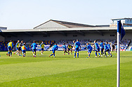 AFC Wimbledon players warming up before kick off during the EFL Sky Bet League 1 match between AFC Wimbledon and Hull City at Plough Lane, London, United Kingdom on 27 February 2021.