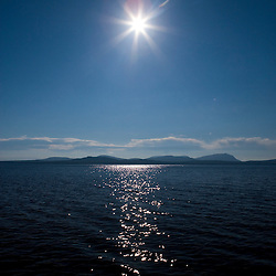 """Sunlight sparkles on Moosehead Lake in Maine's Northern Forest.  View Southeast from """"Big W."""""""