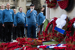 London, UK. 10 November, 2019. Jim Radford (c), D-Day veteran and folk singer, sings '1916' in front of ex-services personnel from Veterans For Peace UK (VFP UK) taking part in the Remembrance Sunday ceremony at the Cenotaph. VFP UK was founded in 2011 and works to influence the foreign and defence policy of the UK for the larger purpose of world peace.