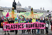 Extinction Rebellion climate activists assemble behind a Plastics Rebellion banner in Trafalgar Square to take part in a colourful March for Nature on the final day of their two-week Impossible Rebellion on 4th September 2021 in London, United Kingdom. Extinction Rebellion are calling on the UK government to cease all new fossil fuel investment with immediate effect.