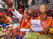 05 MARCH 2017 - KATHMANDU, NEPAL: Newar Buddhist monks lead a service at Seto Machindranath Temple, a 12th century Buddhist temple in Kathmandu. The Newar people are the dominant ethnic group in the Kathmandu valley. Newar Buddhists combine elements of Buddhism and Hinduism in their faith.     PHOTO BY JACK KURTZ