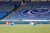 Football - 2020 / 2021 Sky Bet League One - Portsmouth vs. Accrington Stanley - Fratton Park<br /> <br /> Portsmouth players lie on the floor after the final whistle as the fail to reach a play off place on the final game of the season at Fratton Park <br /> <br /> COLORSPORT/SHAUN BOGGUST