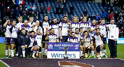 Scotland celebrate with the Auld Alliance Trophy after the final whistle during the NatWest 6 Nations match at BT Murrayfield, Edinburgh.