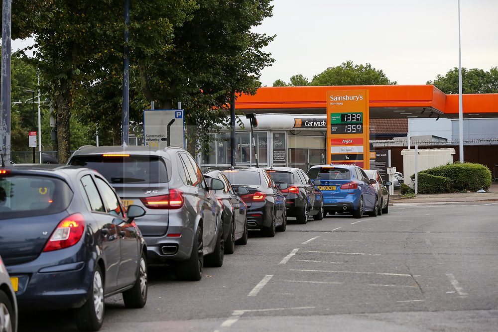 © Licensed to London News Pictures. 28/09/2021. London, UK. Motorists queue for the fifth day of the fuel crisis at Sainsbury's petrol station in north London, amid fears of fuel running out due to a shortage of HGV drivers. The Army is on standby to help ease the fuel supply crisis. Photo credit: Dinendra Haria/LNP