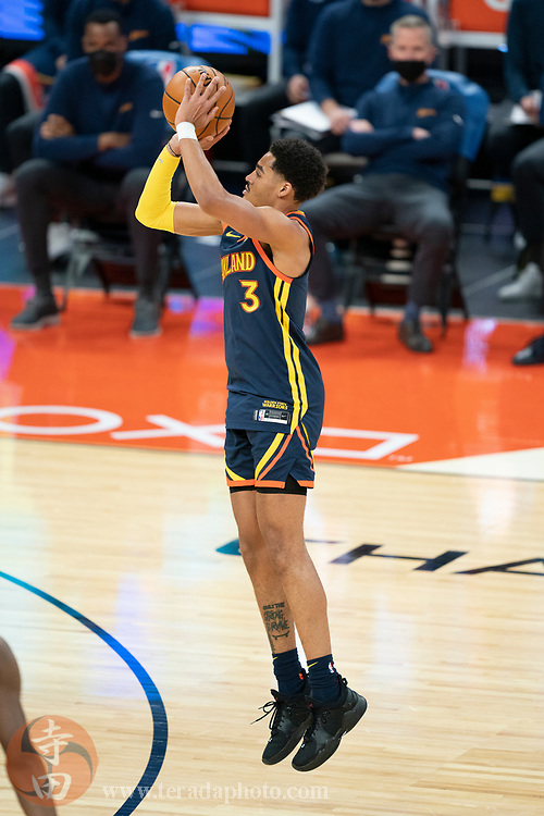 March 23, 2021; San Francisco, California, USA; Golden State Warriors guard Jordan Poole (3) during the first quarter against the Philadelphia 76ers at Chase Center.