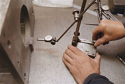 Close up of man using inspection table at engineering works,