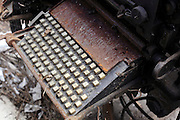 rusted keyboard on a abandoned industrial type setting machine