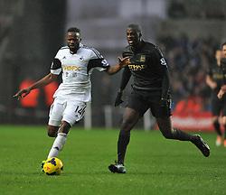 Swansea City's Roland Lamah takes the ball past Manchester City's Micah Richards - Photo mandatory by-line: Alex James/JMP - Tel: Mobile: 07966 386802 01/01/2014 - SPORT - FOOTBALL - Liberty Stadium - Swansea - Swansea City v Manchester City - Barclays Premier League