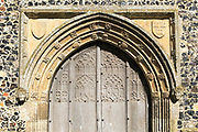 Carved stone wooden doorway arch, Church of All Saints, Brandeston, Suffolk, England, UK