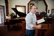 Curtis Hice, 27, is singing during a church service in Winchester, Tennessee, where he works at Social Security office. He lives with his wife and 2-year-old daughter. Curtis was a Marine combat engineer and fought during the first battle for Fallujah. After returning to the USA, he became more devoted and turned into religion. He is now the solo singer at his community church..