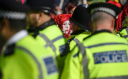 © Licensed to London News Pictures. 10/10/2019. London, UK. Police surround Extinction Rebellion activists who refuse to move from he roads around Trafalgar Square in Westminster, central London where they have been demonstrating for a fourth day running. The climate change group have blockaded the Westminster area, demanding that the government takes immediate and decisive action on climate change. Photo credit: Ben Cawthra/LNP