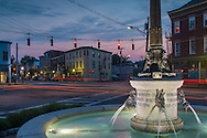 Goshen, New York - Water flows in the Harriman Fountain on the evening of June 10, 2015. The fountain was erected to honor Edward Henry Harriman. The Orange County Horse and Road Improvement Association dedicated the fountain on Feb. 25, 1911, on the anniversary of Harriman's birth. Lights from passing cars formed streaks during the long exposure.
