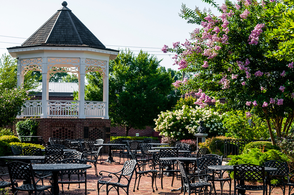 Outdoor seating near a gazebo at Madison Town Park in Madison, Georgia on Saturday, July 17, 2021. Copyright 2021 Jason Barnette