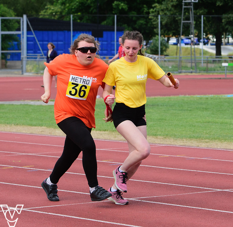 Event: 4x100 meter relay<br /> Competitors, from left: Hannah Bromley-Challenor<br /> <br /> Metro Blind Sport's 42nd Athletics Open, held at Mile End Stadium, Tower Hamlets, London.<br /> <br /> Picture: Chris Vaughan Photography for Metro Blind Sports<br /> Date: June 16, 2018