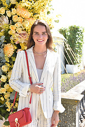 Catie Munnings at the 'Cartier Style et Luxe' enclosure during the Goodwood Festival of Speed, Goodwood House, West Sussex, England. 15 July 2018.