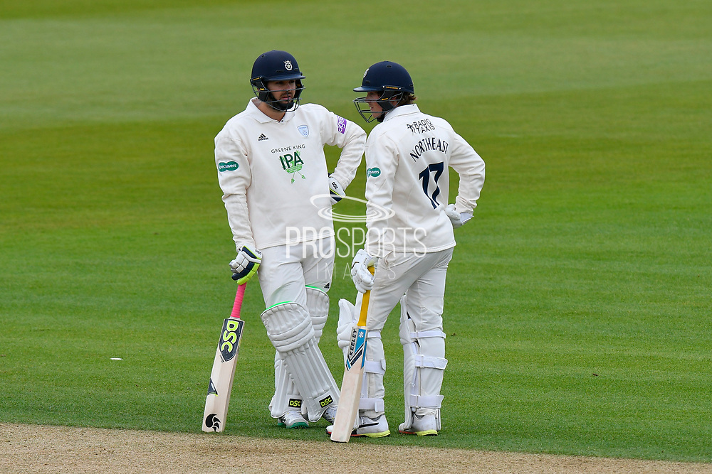 Rilee Rossouw of Hampshire chats with Sam Northeast of Hampshire during the first day of the Specsavers County Champ Div 1 match between Hampshire County Cricket Club and Essex County Cricket Club at the Ageas Bowl, Southampton, United Kingdom on 5 April 2019.