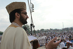 June 16, 2018 - Srinagar, Jammu and Kashmir, India - Kashmiri Muslims offer Eid prayers marking the festival of Eid al-Fitr at  eidgah in Srinagar summer capital of Indian administered Kashmir..Eid al-Fitr marks the end of the holy month of Ramadan, during which Muslims all over the world fast from Dawn To Dusk...Massive clashes erupted between protesters and government forces on 16,June,2018 after Eid prayers at Eidgah, Srinagar, Kashmir .As soon as Eid prayers concluded youth held protest demonstrations.They were chanting pro-Islam and.pro-freedom slogans.Youth hurled stones and bricks on the forces who then lobed tear smoke shells,pelletsto disperse the protesters. (Credit Image: © Shuhaib Zahoor/Pacific Press via ZUMA Wire)