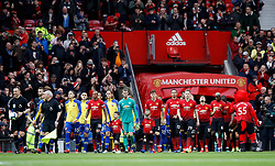 Players walk on to the pitch during the Premier League match at Old Trafford, Manchester.