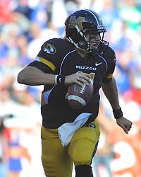 Nov 27, 2010; Kansas City, MO, USA; Missouri Tigers quarterback Blaine Gabbert (11) runs for short yardage in the second half of the game against the Kansas Jayhawks at Arrowhead Stadium. Missouri won 35-7. Mandatory Credit: Denny Medley-US PRESSWIRE