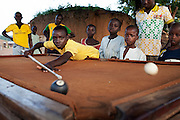 Boys are playing pool in Bagega, pop. 9000, a large village affected by lead poisoning due to the unsafe techniques employed for extracting gold, in Zamfara State, Nigeria. It is mainly caused by ingestion and breathing of lead particles released in the steps to isolate the gold from other metals. This type of lead is soluble in stomach acid and children under-5 are most affected, as they tend to ingest more through their hands by touching the ground, and are developing symptoms often leading to death or serious disabilities.