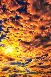 A Fiery Cloud Filled Sky over Broemmelsiek Park near New Melle, Missouri in Wentzville.