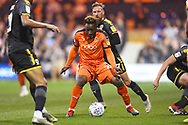 Luton Town player Kazenga LuaLua fights to control the ball in the first half during the EFL Sky Bet League 1 match between Luton Town and AFC Wimbledon at Kenilworth Road, Luton, England on 23 April 2019.