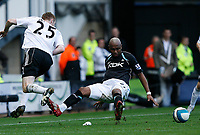 Photo: Steve Bond.<br />Derby County v Bolton Wanderers. The FA Barclays Premiership. 29/09/2007. Stephen Pearson (L) and El-Hadj Diouf (R) in mid air