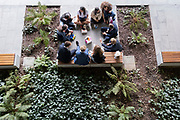 An aerial view of a group of young people sitting with their lunches in the City of London, the capital's financial district, on 21st September 2021, in London, England. Post-Covid pandemic, City workers are returning to their office desks in greater numbers but many still prefer to work from home for at least 1-2 days a week.