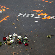 Charlotte, NC- September 21, 2016: A makeshift memorial for Keith Scott sits in the parking space that now serves as a crime scene for the officer involved shooting death that happened just one day earlier. CREDIT: LOGAN R. CYRUS FOR THE NEW YORK TIMES