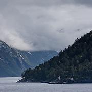 Three weeks aboard the Kong Harald. Hurtigruten, the Coastal Express. Landscape near Alesund and the Geirangerfjolrd.