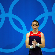 Tara Cunningham of Stilwell, Kan. paused for a few moments to prepare for her lift in the women's 48kg weightlifting competition at the Athens Summer Olympic Games. Cunningham, the 2000 gold medalist, finished 11th in the competition.
