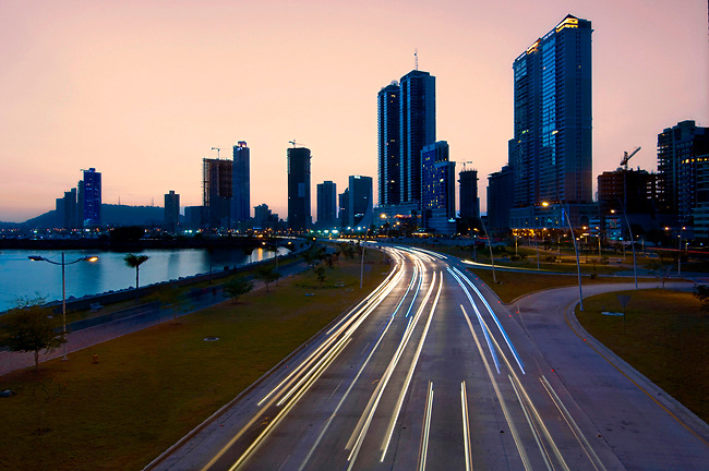 Dawn illuminates the high rises of Panama City and reduces speeding cars to streaks of light on Balboa Avenue and the Cinta Costera.