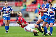 Manchester United midfielder Leah Galton (11) tackles Reading defender Deanna Cooper (14) during the FA Women's Super League match between Manchester United Women and Reading LFC at Leigh Sports Village, Leigh, United Kingdom on 7 February 2021.