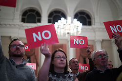 """© Licensed to London News Pictures . 18/11/2014 . Kent , UK . Audience voting """" NO """" in response to a question at a hustings in the Rochester and Strood by-election , held at the Corn Exchange in Rochester , this evening ( 18th November 2014 ) . Photo credit : Joel Goodman/LNP"""