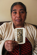 Woman holding photo of her grandmother. Bogota, Columbia<br /> <br /> Roma came to the Americas as early as Christopher Columbus's first voyage. Roma were exported and sold as slaves along with negroes from Africa. Europe tried to solve its 'roma problem' by deporting many Roma slaves to the americas. In the 1920s Roma, Chinese and mentally handicapped were not allowed to enter the USA anymore. After that Roma went to South America and the Carribean with a view to traveling north across borders, but many ended up by setting up communities in the southern hemisphere. Nowadays about two million Roma live between North and South America.