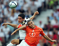 Fotball,  Portugal, EM, Euro 2004, 150604, Tyskland - Nederland<br />  Kevin Kuranyi, Tyskland og Wilfred Bouma, Nederland<br /> Photo:Digitalsport