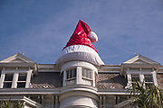 A giant Santa hat tops the roof of a historic home decorated for Christmas on Meeting Street in Charleston, SC.