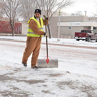 City of Gallup worker Gerry Francis, 56, scrapes the side walk along E. Aztec Ave in Gallup Tuesday.