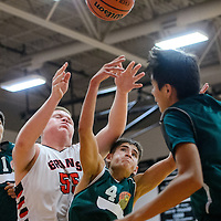 121814       Cable Hoover<br /> <br /> Thoreau Hawk Montana Miller (4) and Grants Pirate Bradley Hatten (55) compete for a rebound during the first round of the Eddie Pena Holiday Classic Thursday at Grants High School.