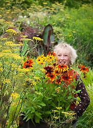 Carol Klein with box of Rudbeckia 'Rustic Dwarf' ready to plant out