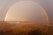 Double, 210-degree rainbow at sunset, Deadhorse Point, Utah