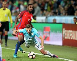 Danny Rose of England fouls Roman Bezjak of Slovenia - Mandatory by-line: Robbie Stephenson/JMP - 11/10/2016 - FOOTBALL - RSC Stozice - Ljubljana, England - Slovenia v England - World Cup European Qualifier