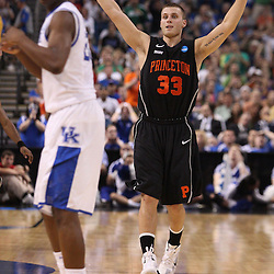 Mar 17, 2011; Tampa, FL, USA; Princeton Tigers guard Dan Mavraides (33) celebrates after hitting a shot during second half of the second round of the 2011 NCAA men's basketball tournament against the Kentucky Wildcats at the St. Pete Times Forum. Kentucky defeated Princeton 59-57.  Mandatory Credit: Derick E. Hingle