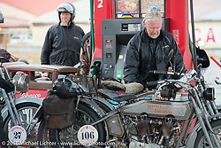 Thomas Trapp, owner of the Harley-Factory Frankfurt dealership in Germany with his 1916 Harley-Davidson at a rainy gas stop during the Motorcycle Cannonball Race of the Century. Stage-11 ride from Durango, CO to Page, AZ. USA. Wednesday September 21, 2016. Photography ©2016 Michael Lichter.