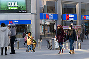 People wearing face masks in the Bull Ring shopping area in the City Centre on the day it was announced that Birmingham would be placed in tier three for very high alert level of the new Coronavirus tier system following the end of the second national lockdown on 26th November 2020 in Birmingham, United Kingdom. The national lockdown and following tier 3 status is a huge blow to the economy and for individual businesses in Britain's second city, who were already struggling after eight months of Covid-19 restrictions. In tier 3 people can only meet other households in outdoor public spaces like parks, where the rule of six applies.