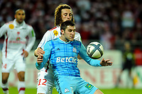 FOOTBALL - FRENCH CHAMPIONSHIP 2010/2011 - L1 - STADE BRESTOIS v OLYMPIQUE MARSEILLE - 22/12/2010 - PHOTO PASCAL ALLEE / DPPI - ANDRE-PIERRE GIGNAC (OM) / PAUL BAYSSE (BREST)